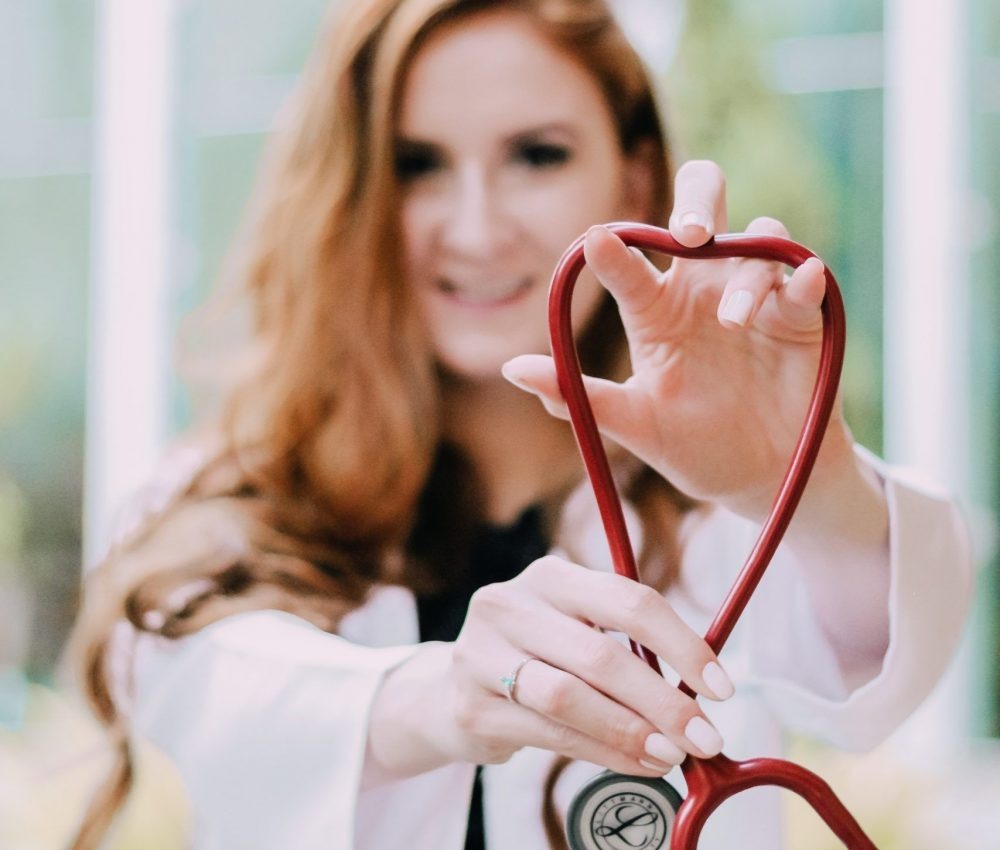 photo-of-woman-holding-red-stethoscope-3408368